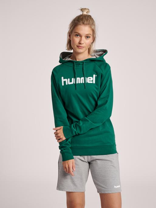 HUMMEL GO COTTON LOGO HOODIE WOMAN, EVERGREEN, model
