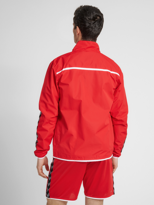 hmlAUTHENTIC TRAINING JACKET, TRUE RED, model
